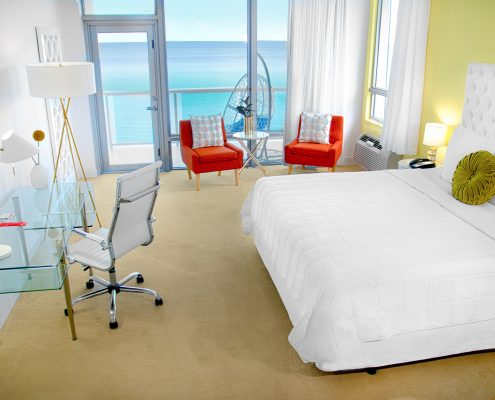 Deluxe oceanfront bed and desk