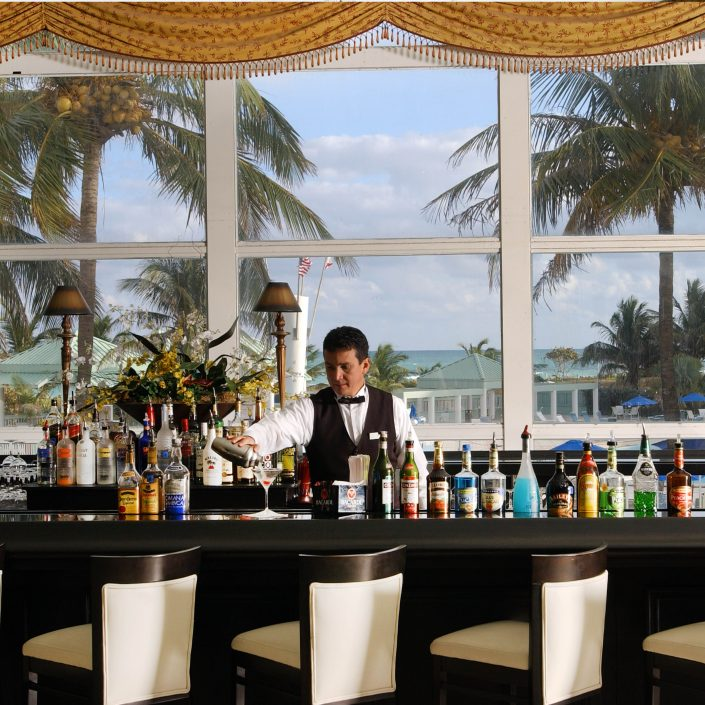 Server preparing drink at the Lobby Bar at the Deauville Beach Resort